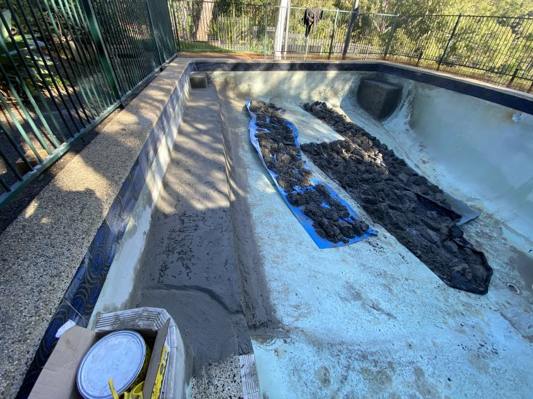 Pool renovation: New bench seat to existing concrete pool.